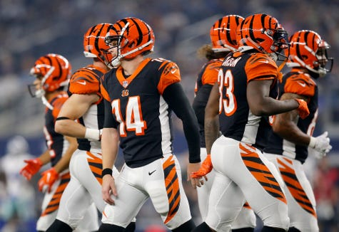 Cincinnati Bengals quarterback Andy Dalton (14) walks off the field after another three-and-out drive in the first quarter of the NFL Preseason Week Two game between the Dallas Cowboys and the Cincinnati Bengals at AT&T Stadium in Arlington, Texas, on Saturday, Aug. 18, 2018.