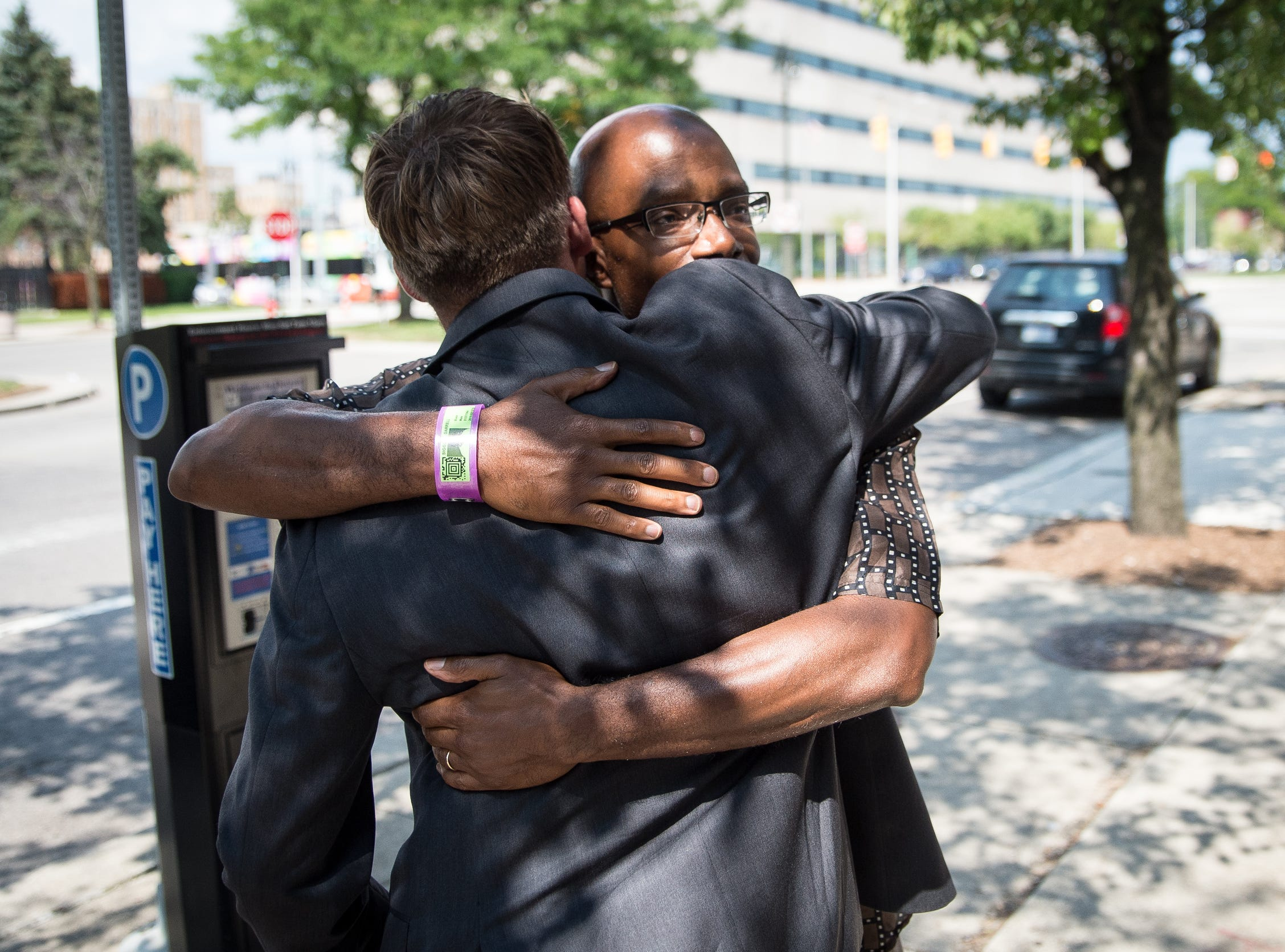 Darrell Siggers hugs his attorney Mike Waldo on Grand Boulevard in Detroit on Aug. 10, 2018. Siggers was released from The William Dickerson Detention Facility in Detroit that day, after serving 34 years in prison.