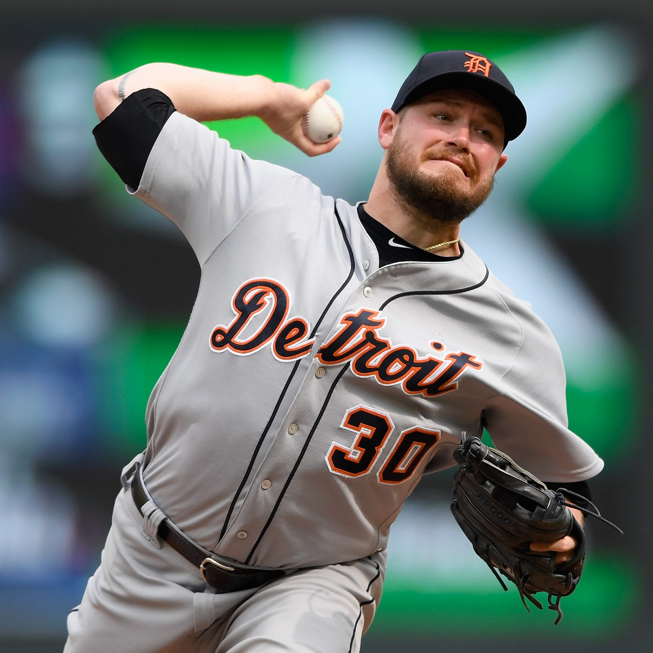 Tigers pitcher Alex Wilson delivers a pitch...
