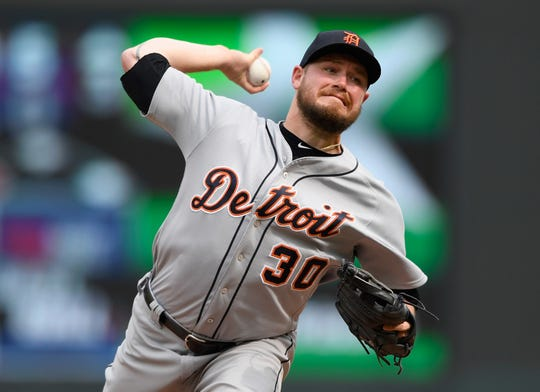 Tigers pitcher Alex Wilson delivers a pitch during the eighth inning of the Tigers' 5-4 loss on Sunday, Aug. 19, 2018, in Minneapolis.