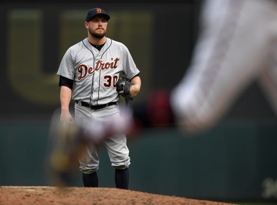 Tigers pitcher Alex Wilson looks on as Twins left fielder Eddie Rosario rounds the bases after hitting a solo home run during the eighth inning of the Tigers' 5-4 loss on Sunday, Aug. 19, 2018, in Minneapolis.