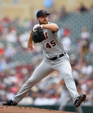 Tigers pitcher Buck Farmer delivers a pitch during the first inning on Sunday, Aug. 19, 2018, in Minneapolis.