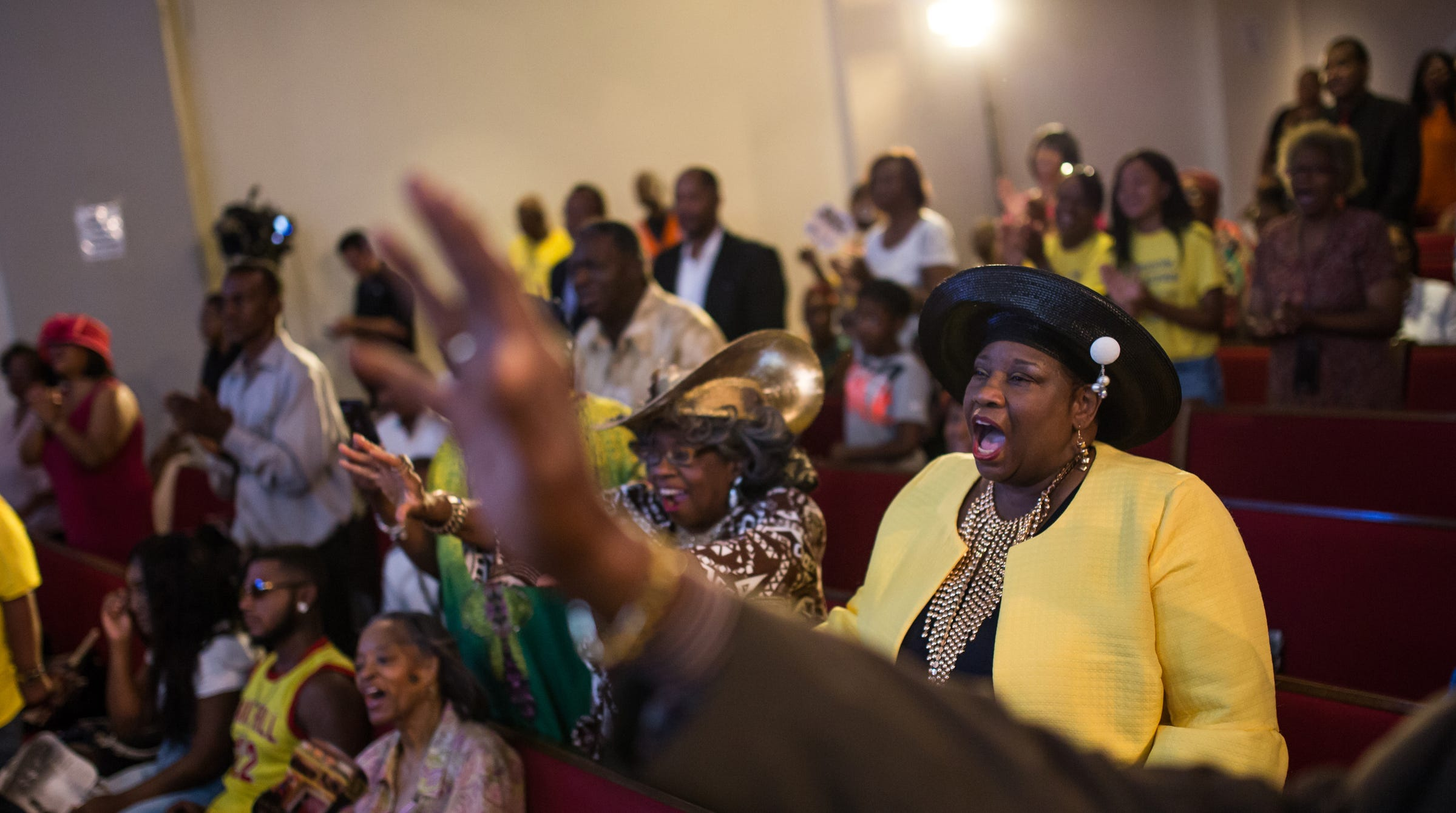 Peggy Tyler of Detroit, center, and Fannie Tyler of Detroit, left, shout along with the congregation during service as the Rev. Jesse Jackson speaks at New Bethel Baptist Church in Detroit where Aretha Franklin grew up attending on Sunday, August 19, 2018.