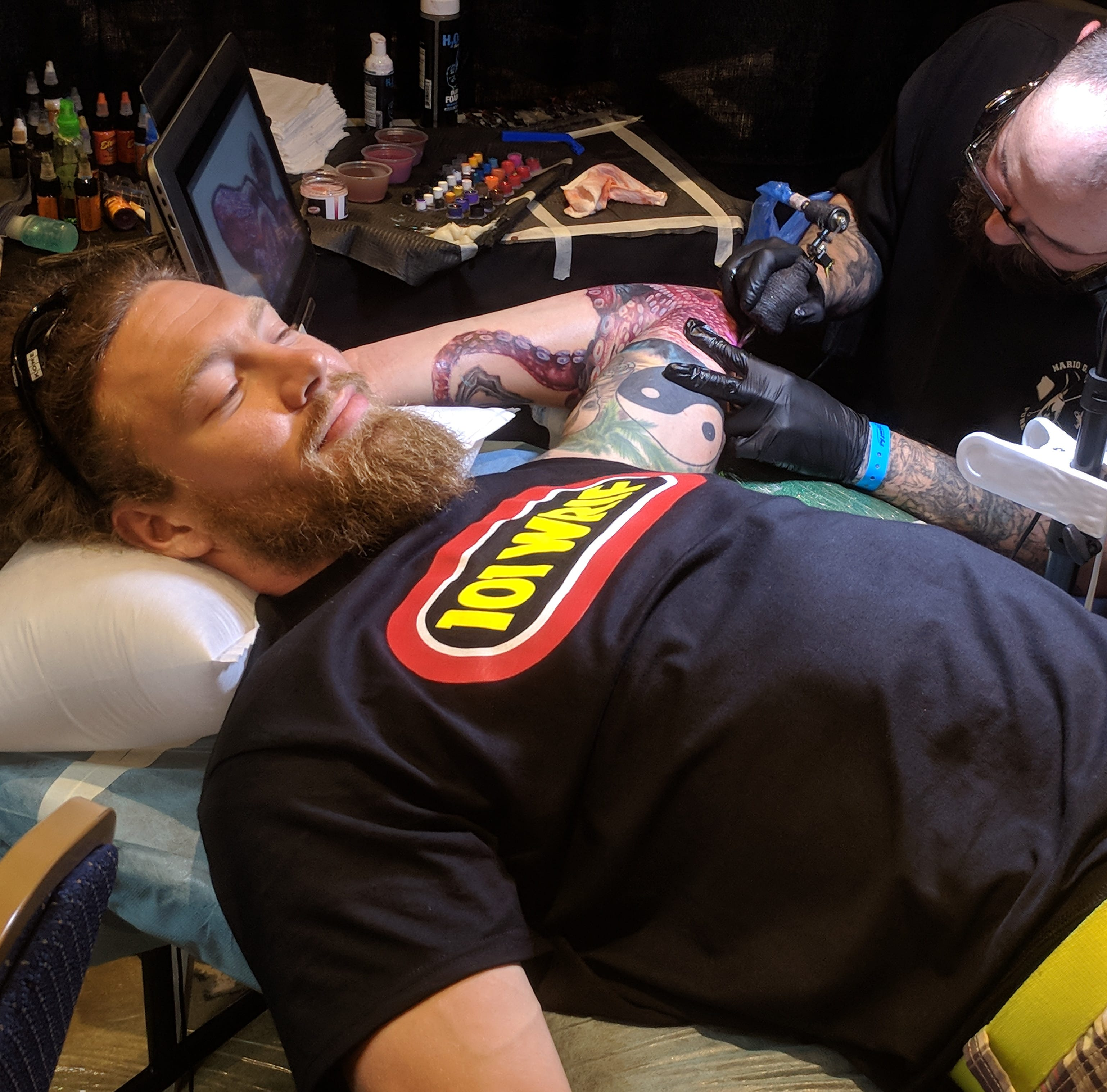 Ryan Paxson, 27, of Brighton, receives a tattoo from artist Sam H., of Arizona, at the second annual Detroit Summer Tattoo Expo at the Renaissance Center in Detroit.