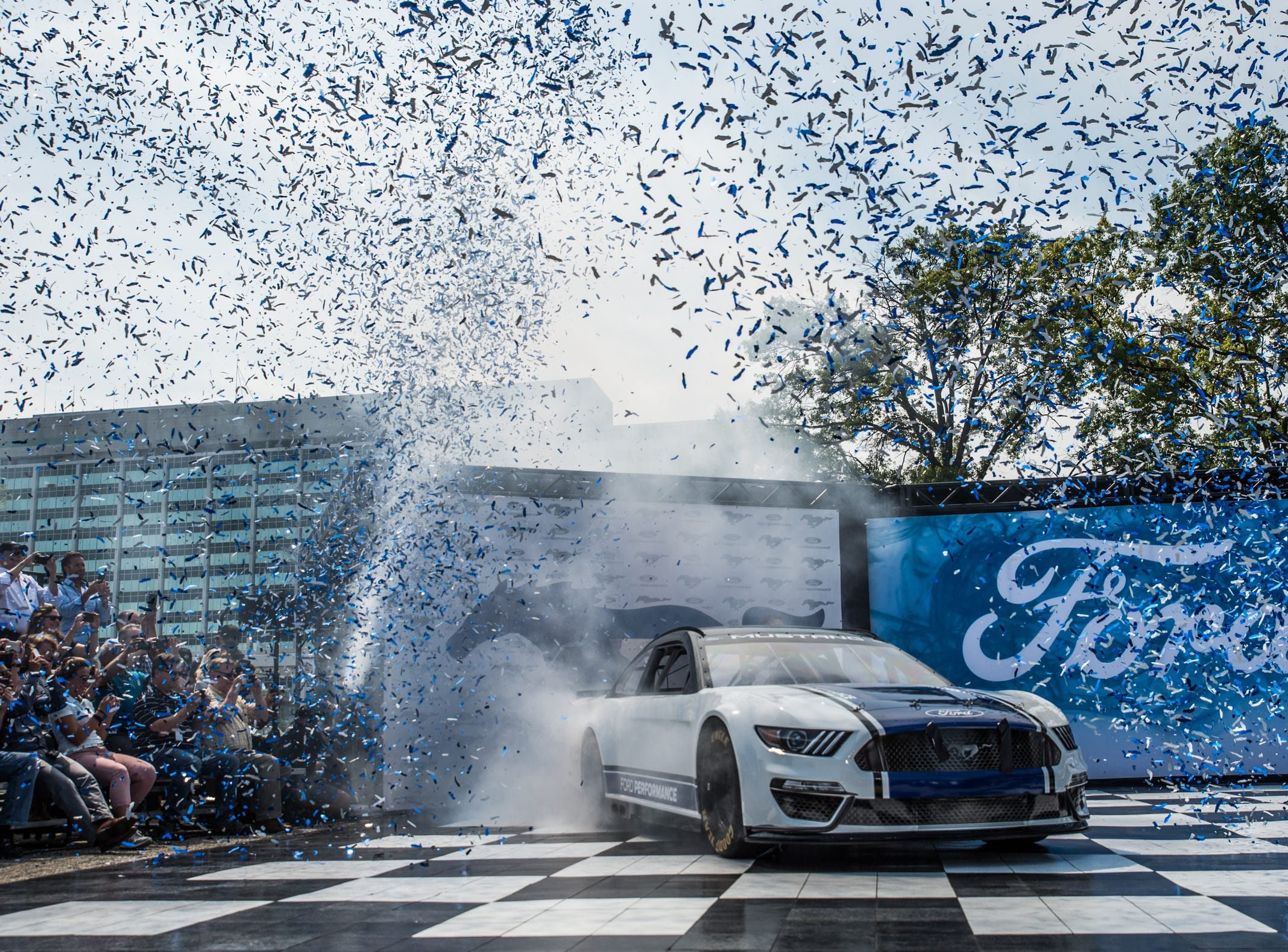 The new Ford Mustang race car is unveiled at Ford Motor Co.'s World Headquarters in Dearborn on Aug. 9, 2018. The car will debut at Daytona in Feb. 2019.