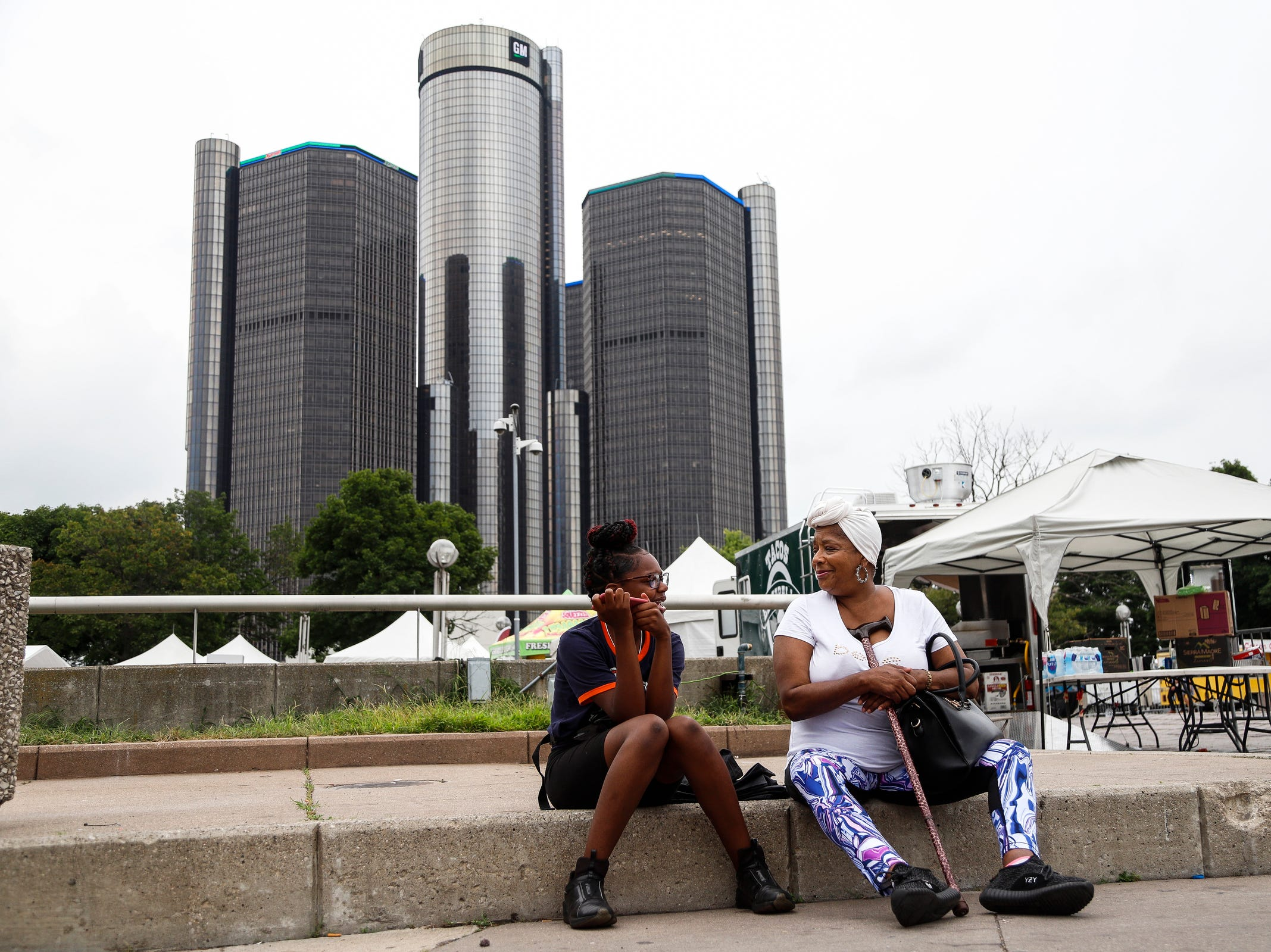 Sydney Simmons, 14, talks to his grandmother Beverly Render, both of Eastpointe, as they listen to the band Seatbelts perform at Hart Plaza during the Motor City Muscle, a free festival celebrating rock and muscle cars, in downtown Detroit on Friday, August 17, 2018.