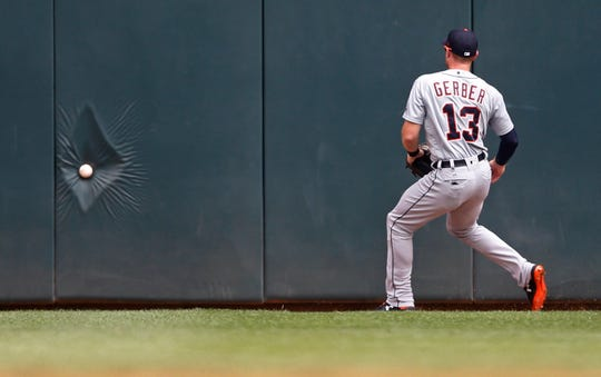 The baseball hits the wall as Tigers center fielder Mike Gerber gives chase on a double fly ball by Twins shortstop Jorge Polanco in the fourth inning on Sunday, Aug. 19, 2018, in Minneapolis.