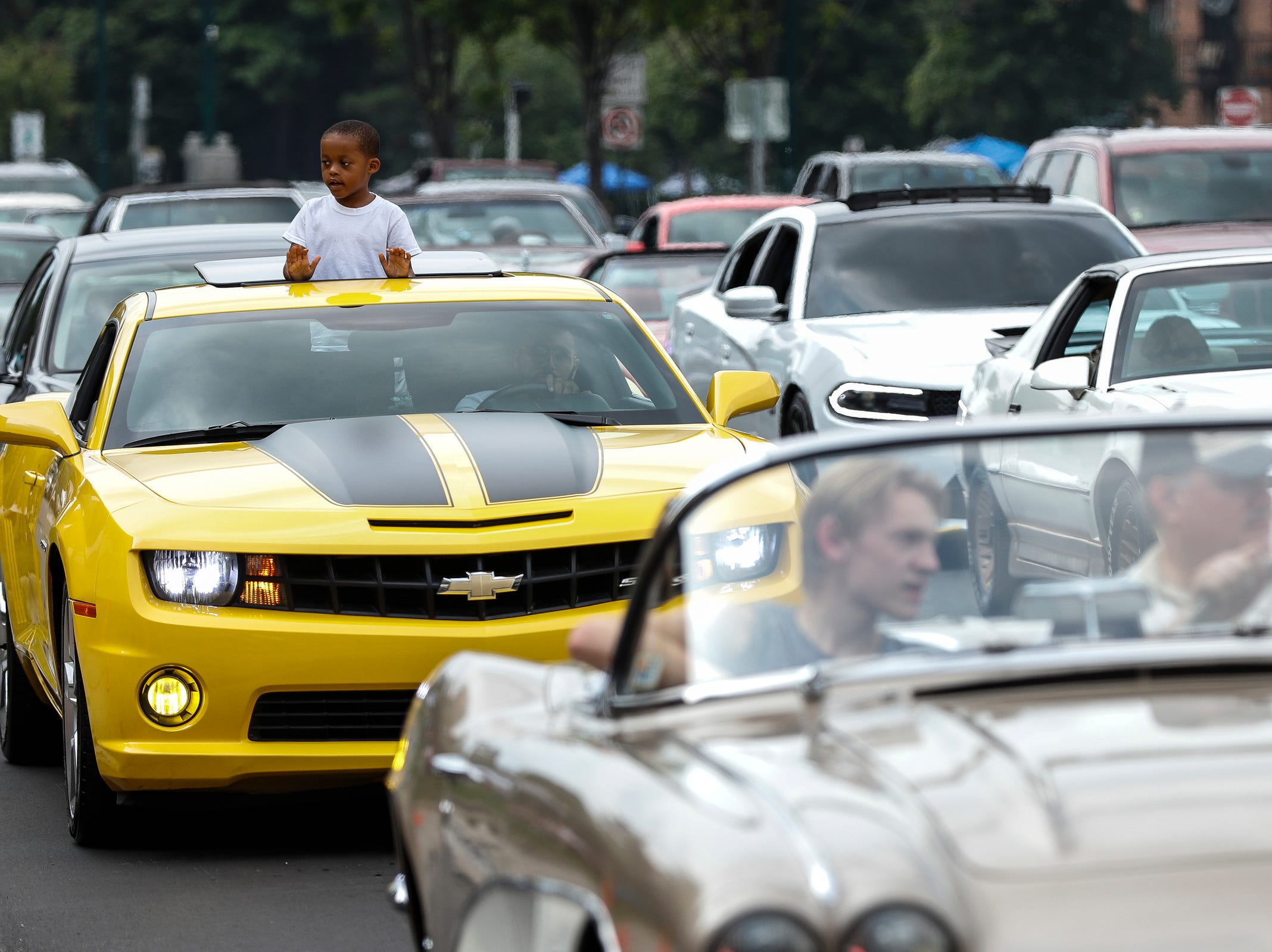 Classic and modern cars cruise along Woodward Avenue in Birmingham during the Woodward Dream Cruise, Saturday, August 18, 2018.