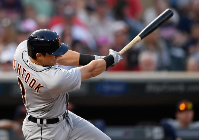 Mikie Mahtook #8 of the Detroit Tigers hits a three-run home run against the Minnesota Twins during the fifth inning of the game on August 18, 2018 at Target Field in Minneapolis, Minnesota.