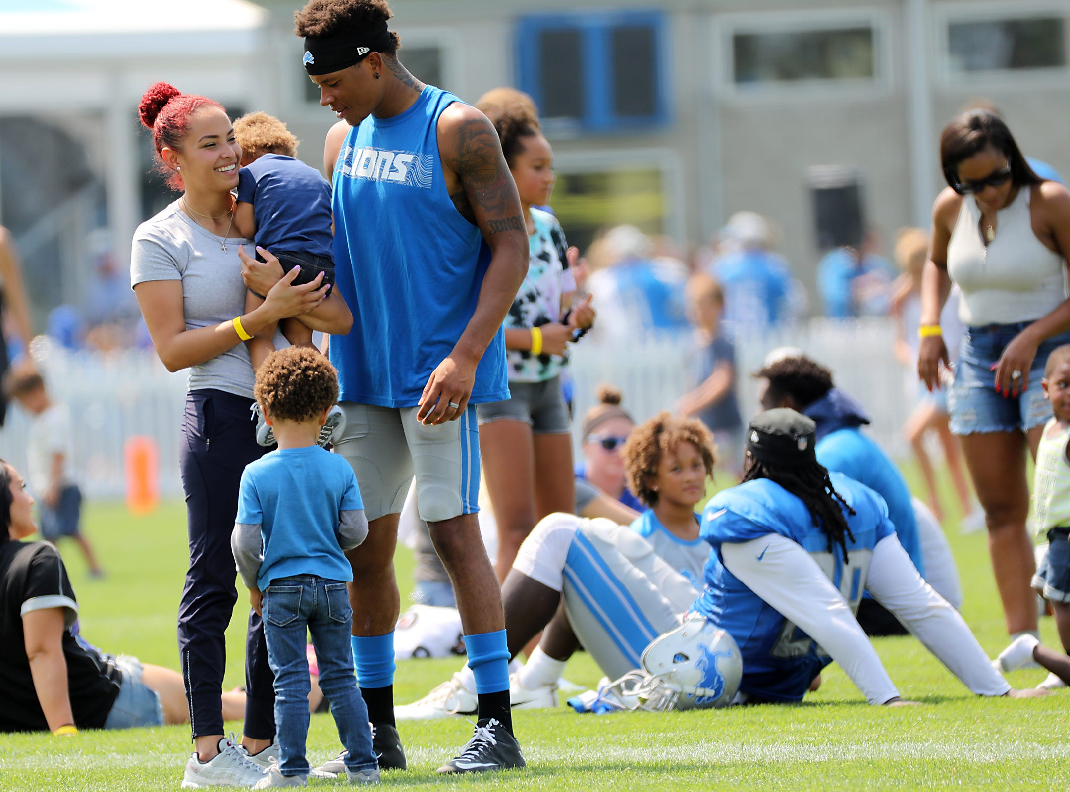 Detroit Lions wide receiver Marvin Jones Jr. greets his family after the Detroit Lions training camp with the New York Giants on Tuesday, Aug. 14, 2018.