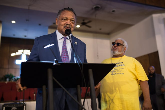 The Rev. Jesse Jackson speaks to the congregation at New Bethel Baptist Church in Detroit as Rev. Robert Smith Jr. of New Bethel Baptist Church stands during a prayer service in honor of Aretha Franklin on Aug. 19, 2018.