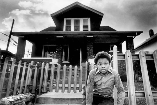 Danny Baxter, 10, poses in front of Dr. Ossian Sweet's old house on Garland in Detroit on Nov. 3, 1975, where a white man fell dead from a shot fired on Sept. 8, 1925. The 1925 trial of Dr. Sweet and his family that defended itself against a white mob is detailed in a historical book released in March 2004.