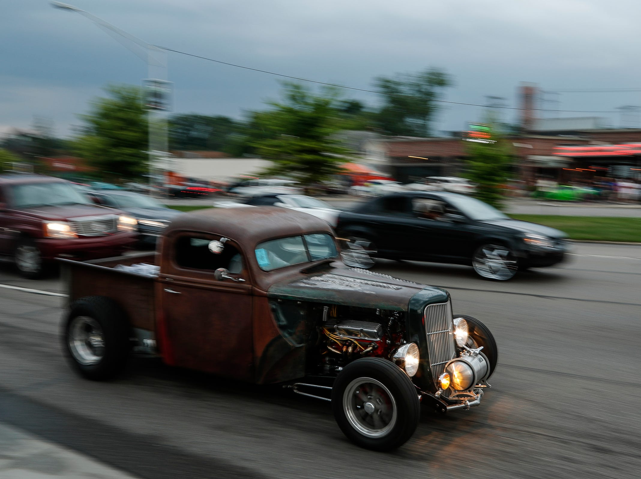 Classic and modern cars cruise along Woodward Avenue in Royal Oak during the Woodward Dream Cruise, Saturday, August 18, 2018.