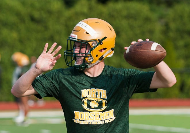 Quarterback Joe Ayrault and Grosse Pointe North move to the MAC White Division.