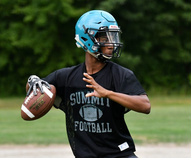 Charles Coy takes over at quarterback at Romulus Summit Academy.