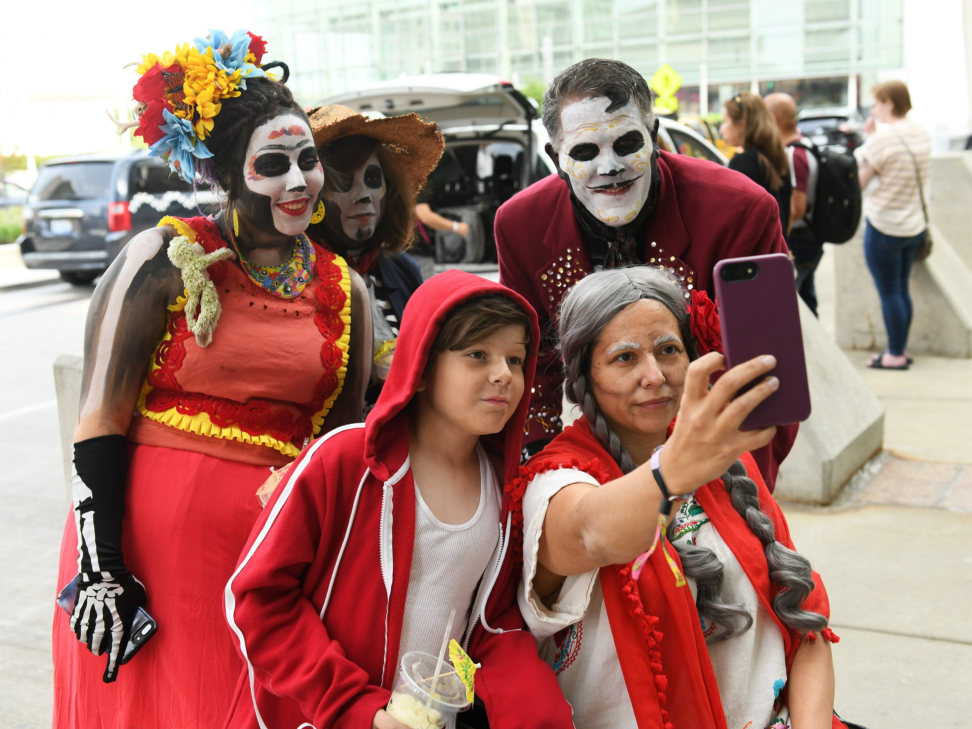 "The Shelton family from Bruce Township are dressed as characters from the movie ""Coco"" take a selfie at the Michigan Comic Con. The Shelton family is Josette, 42, as ""Mama Coco"", front right, Elisha, 9, as ""Miguel"" front left, and in back from left, Rica, 19, as Frida Kahlo, Reina, 13, as ""Hector"", Charlie, 44, as ""Ernesto de la Cruz."""