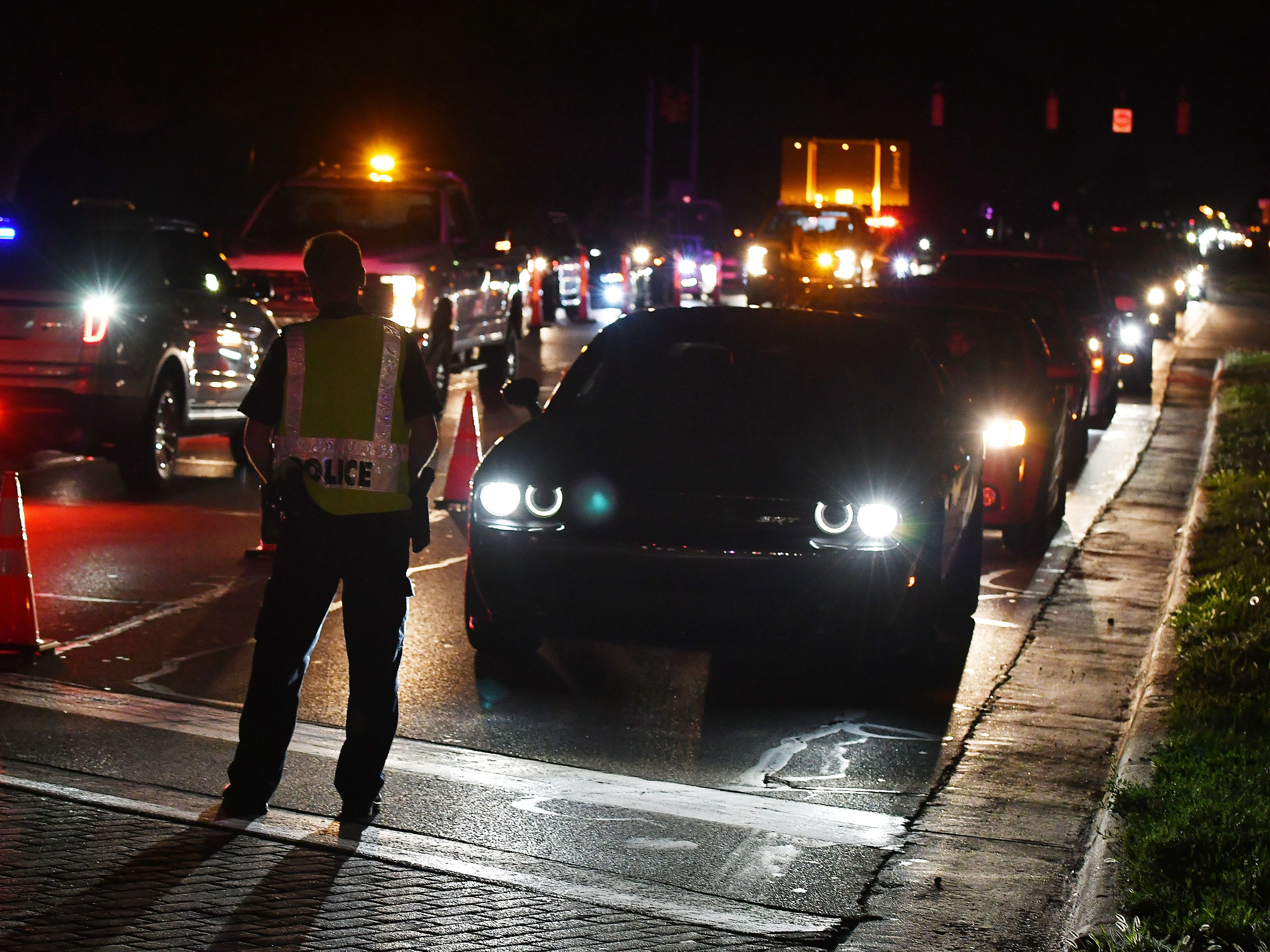 Law enforcement officers begin to clear the traffic off Woodward as 2018 Woodward Dream Cruise comes to an end Saturday night.
