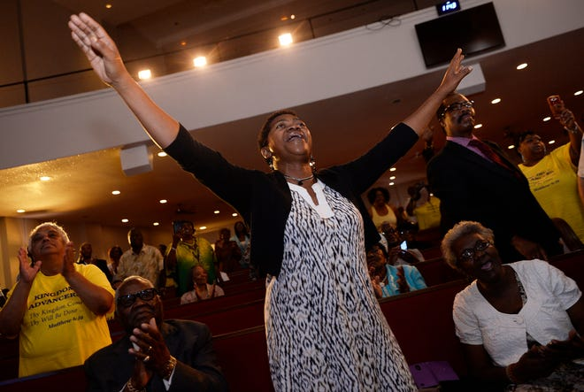 Avis Doughton, 52, of Detroit and a life long member of New Bethel Baptist church sings and worship during the sermon by the Rev. Jesse Jackson on Sunday at New Bethel Baptist Church.
