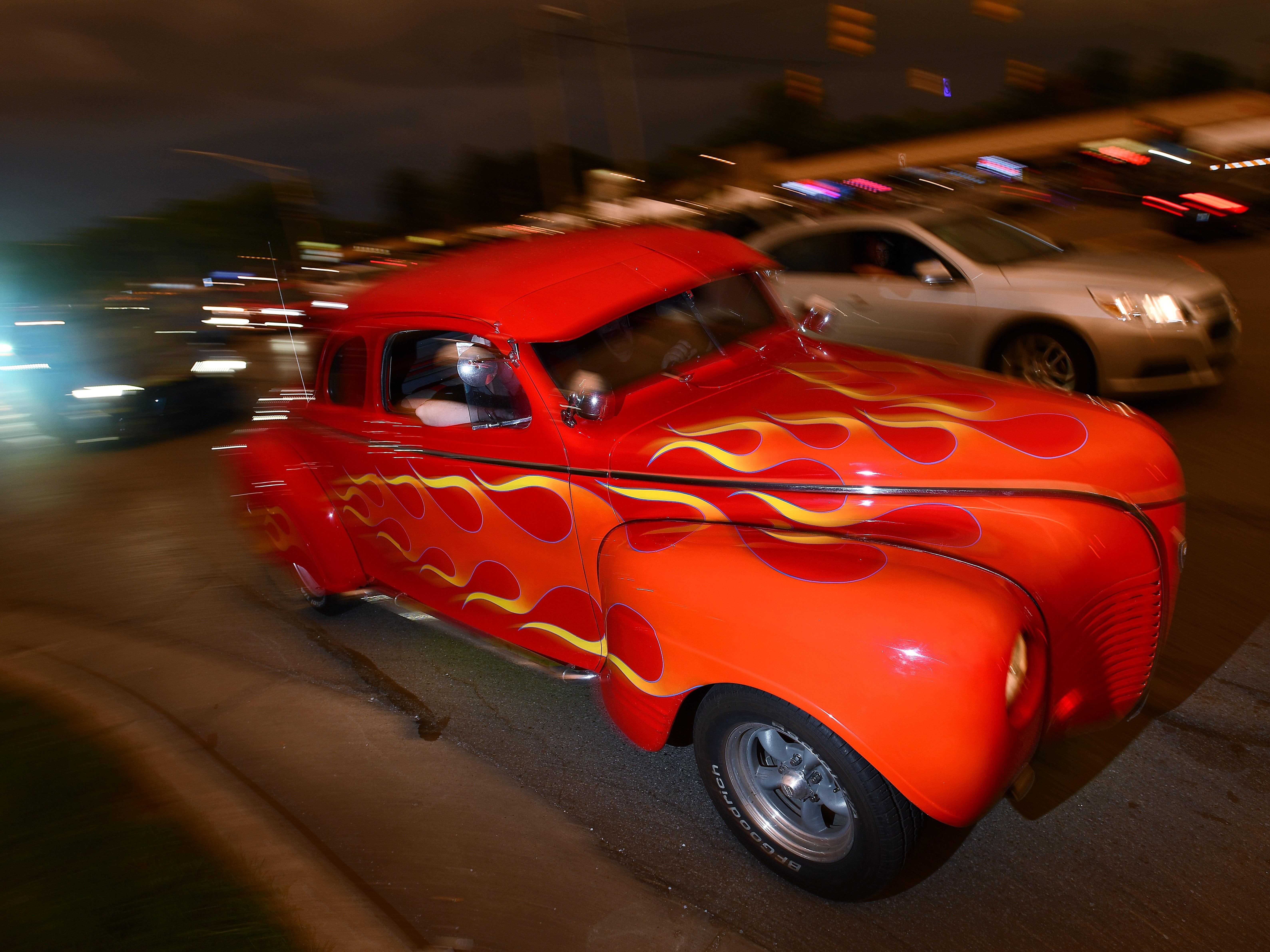 A 1941 hot rod makes its way along Woodward Avenue Saturday night.