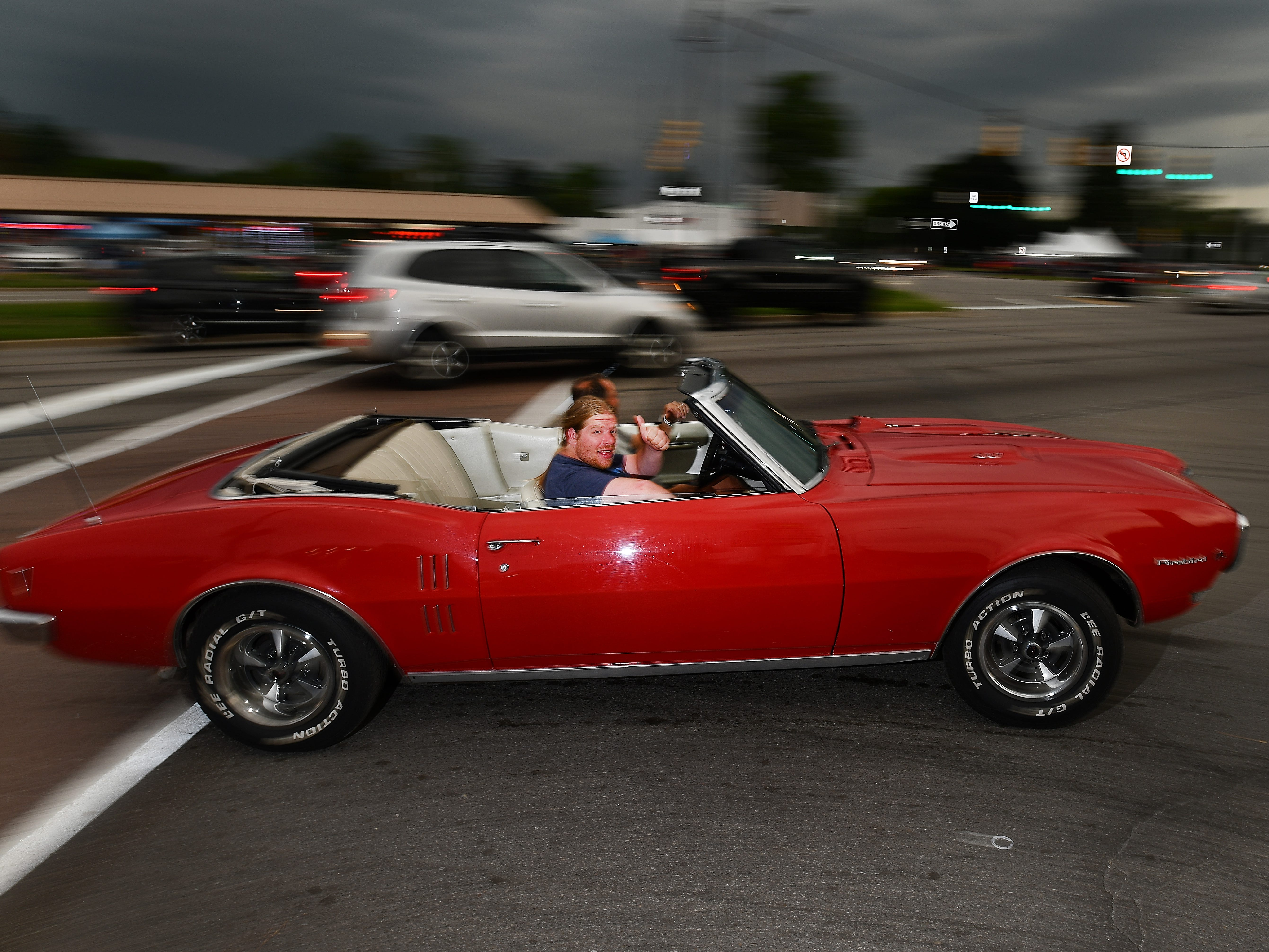 Thumbs up for a Firebird streaking by on Woodward Avenue Saturday night.