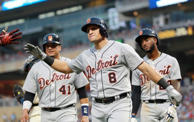 Detroit Tigers' Mikie Mahtook (8) celebrates his three-run home run with teammates Victor Martinez (41) and Niko Goodrum in the fifth inning on Saturday.