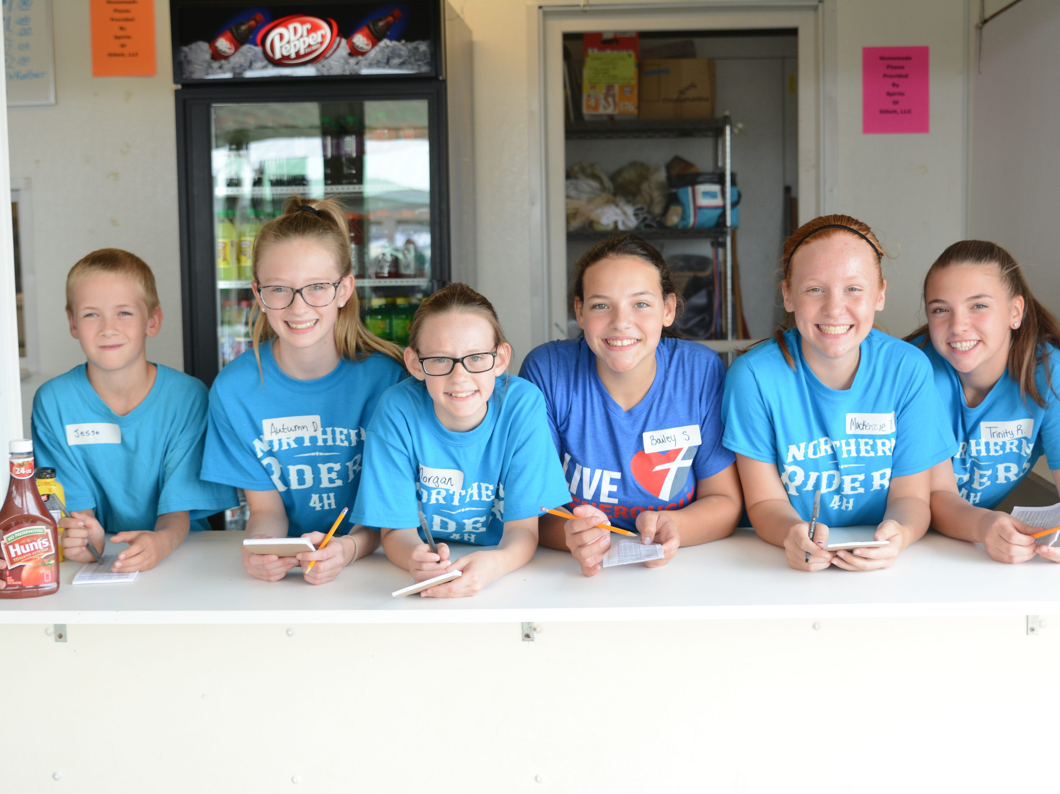 Members of the Northern Riders 4H Club are ready to take orders at the 4H Food Stand at the Oconto County Fair on Friday, Aug. 17. Proceeds supports programming, youth leadership and projects. From left are Jesse Telford, Autumn Dryja, Morgan Dryja, Bailey Stuart, Mackenzie Bailey, Trinity Remic.