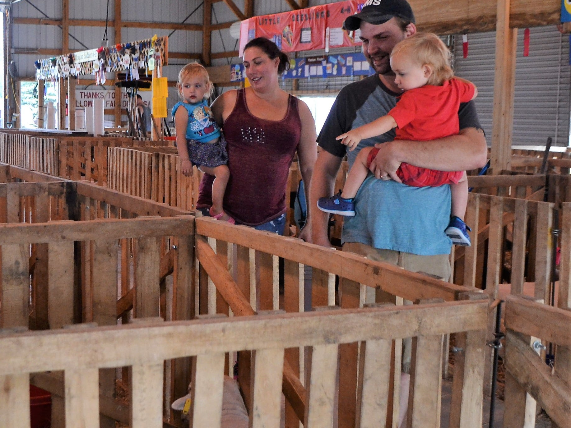 Grace and Brandon DeCremer of Shawano took their 1-1/2-year-old twins, Delaney and Dylan, to see the animals at the Oconto County Fair on Saturday, Aug. 18.