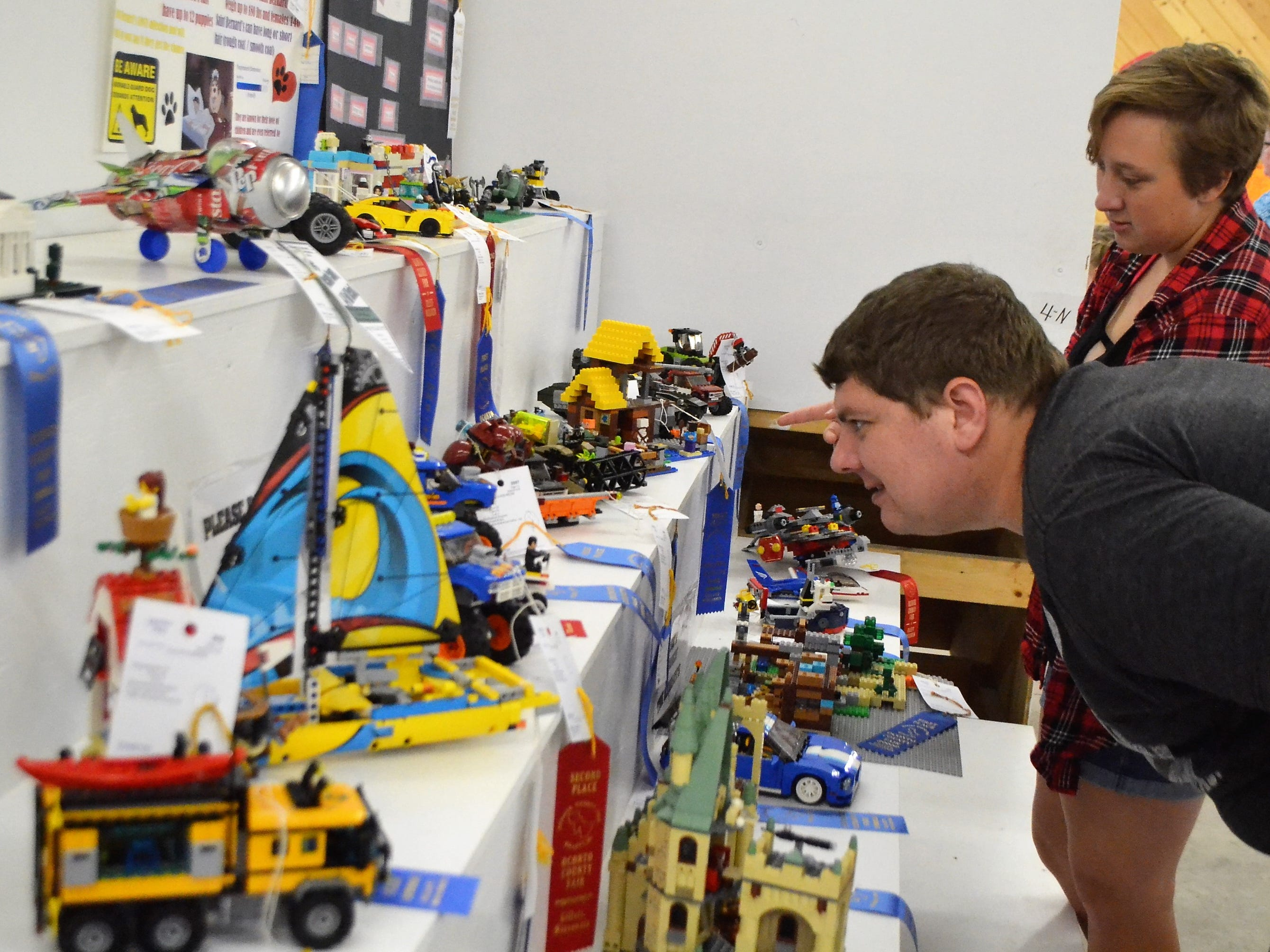 Johnny Howe of Lena takes a close look Saturday, Aug. 18, at the Lego creations entered at the Oconto County Fair, with his cousin, Naomi Wilson of West Allis.