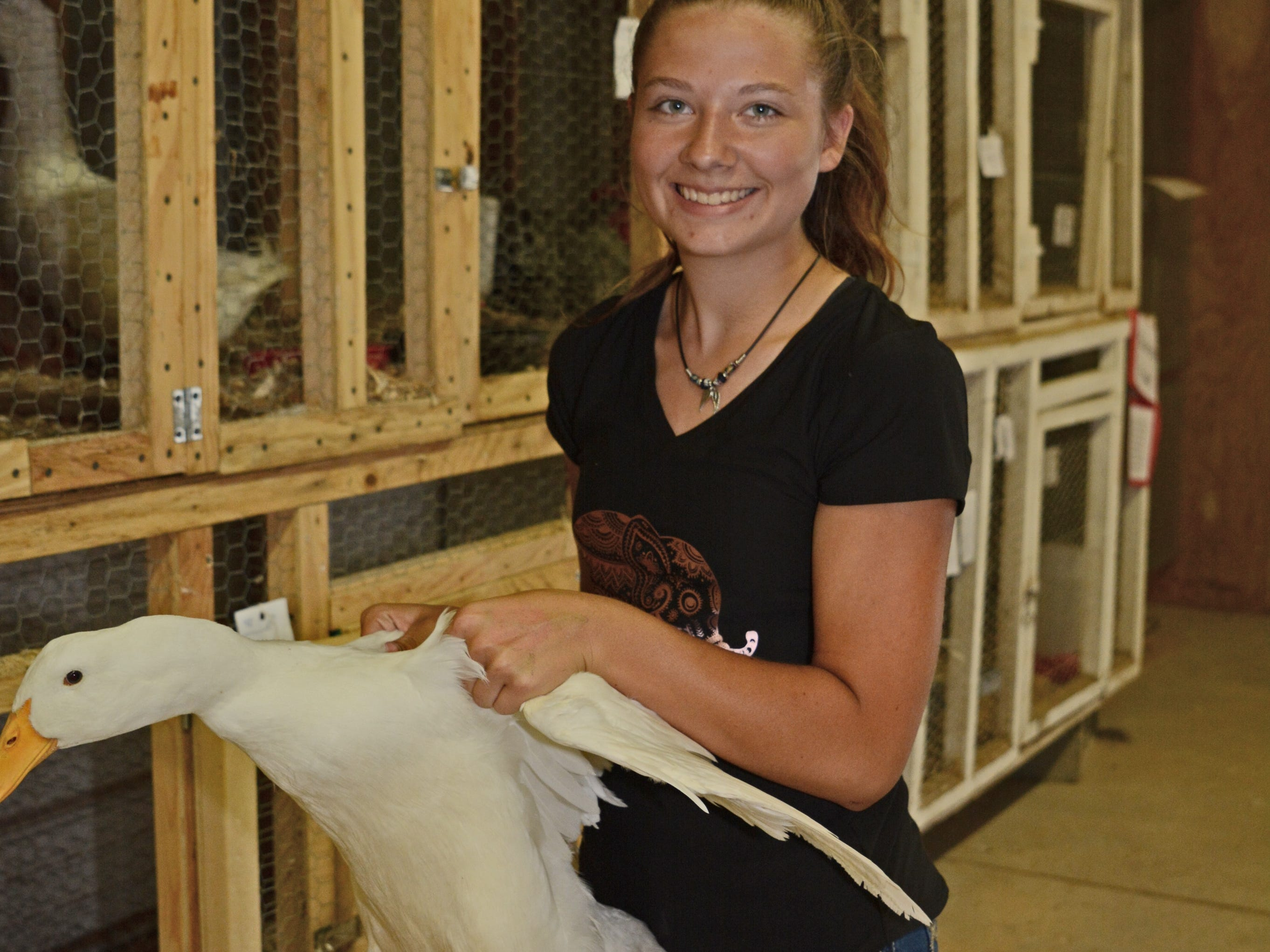 Holly Brock, 14, of Northern Riders 4H Club, holds her Heavyweight Duck.