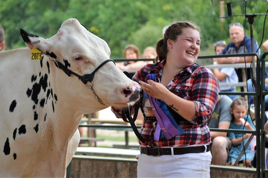 Alexandra Raddatz of Christy Brook 4-H Club smiles after winning both overall  Grand and Reserve Champion awards in the Junior Dairy Cattle Competition at the Oconto County Fair.