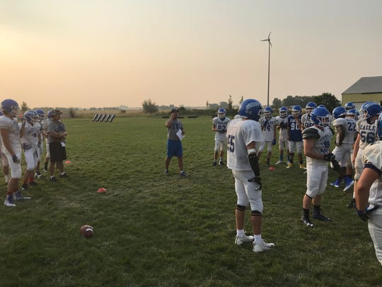 Fairfield head football coach Les Meyer talks to his team during an early morning preseason practice last week at the 'Eagles' Nest.'