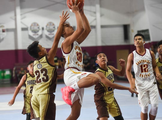 Southern United's Xander Sanchez (10) goes for a layup during the Bank of Guam SummerJam Basketball Tournament 14U Championship game at Tamuning Gym on Aug. 19, 2018.