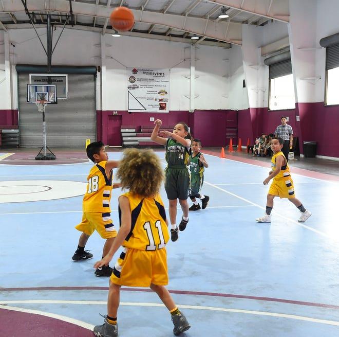 Sinajana Rockers player Amalya Sanchez (14) shoots an outside jump shot against the Dededo Yellow Jackets during the Bank of Guam SummerJam Basketball Tournament 8U Championship game at Tamuning Gym on Aug. 19, 2018.