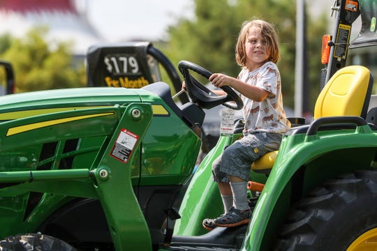Fenton Mee, 4, sits atop a large tractor on closing day of the Indiana State Fair at the State Fairgrounds in Indianapolis, Sunday, Aug. 19, 2018.