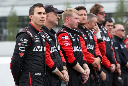 Aug 19, 2018;  Verizon IndyCar Series driver Robert Wickens (left) stands with his team on pit road prior to the ABC Supply 500 at Pocono Raceway.
