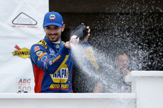 Alexander Rossi celebrates in Victory Lane after winning the IndyCar auto race at Pocono Raceway, Sunday, Aug. 19, 2018, in Long Pond, Pa.