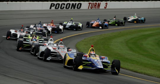 Alexander Rossi (27) leads the field through Turn 3 during a restart of the IndyCar auto race at Pocono Raceway, Sunday, Aug. 19, 2018, in Long Pond, Pa.