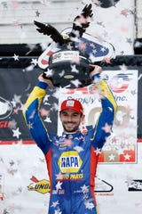Alexander Rossi poses in Victory Lane after winning the IndyCar auto race at Pocono Raceway, Sunday, Aug. 19, 2018, in Long Pond, Pa.