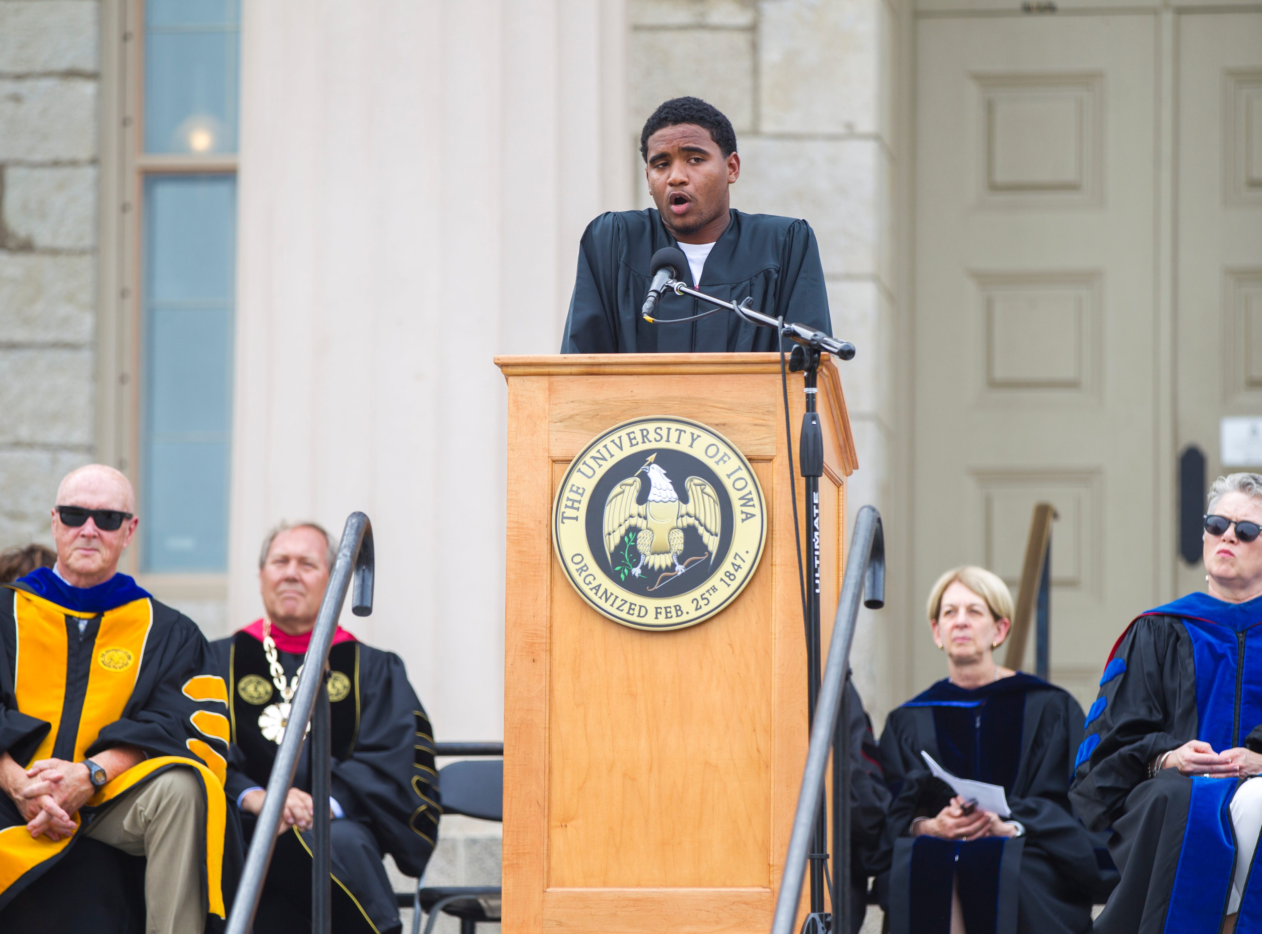 Darius Christiansen, of New Orleans, speaks during the University of Iowa class of 2022 convocation on Sunday, Aug. 19, 2018, at the Pentacrest in Iowa City. Christiansen is a freshman studying creative writing and anthropology.