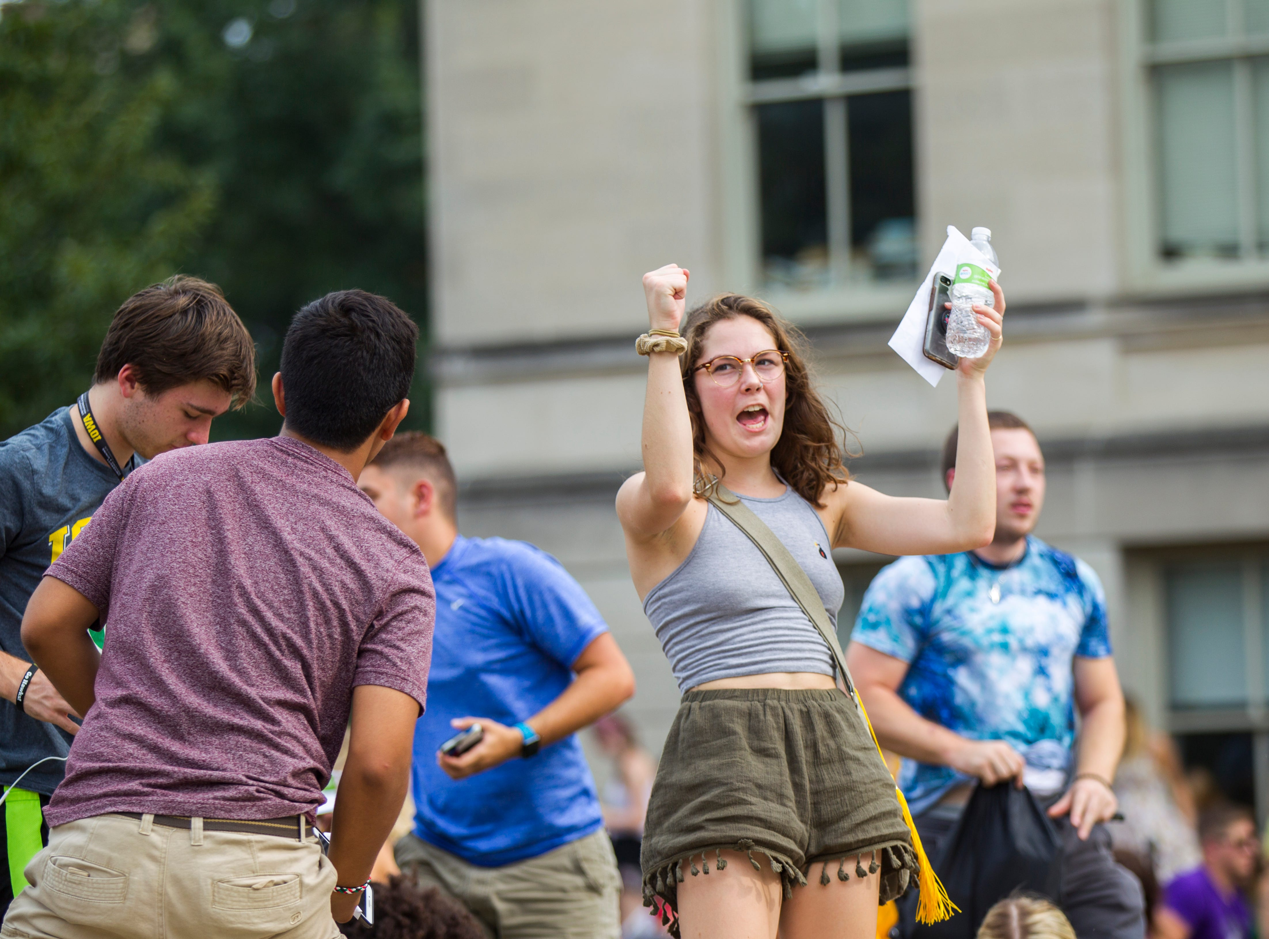 A student celebrates during the University of Iowa class of 2022 convocation on Sunday, Aug. 19, 2018, at the Pentacrest in Iowa City.