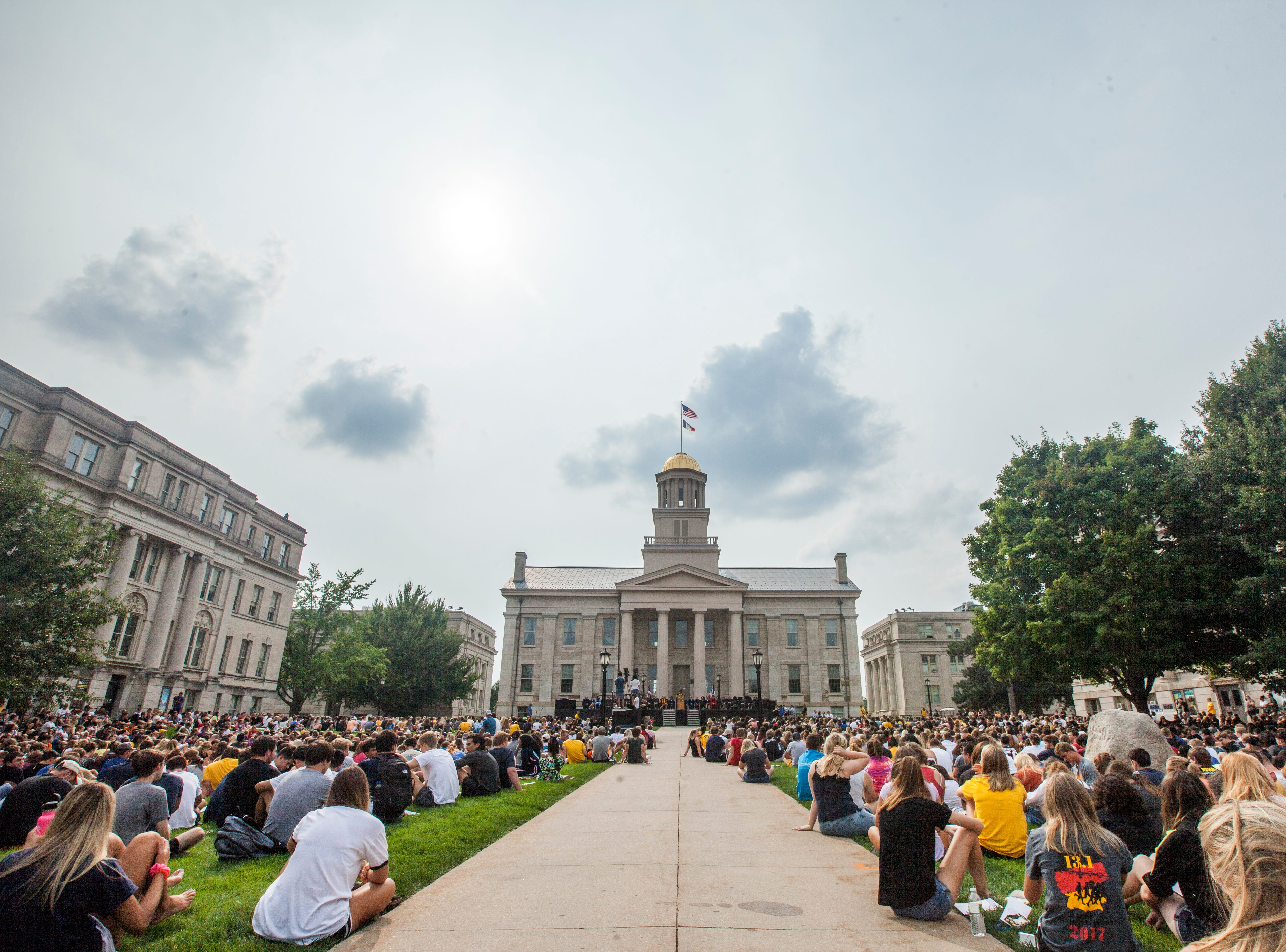Students listen during the University of Iowa class of 2022 convocation on Sunday, Aug. 19, 2018, at the Pentacrest in Iowa City.