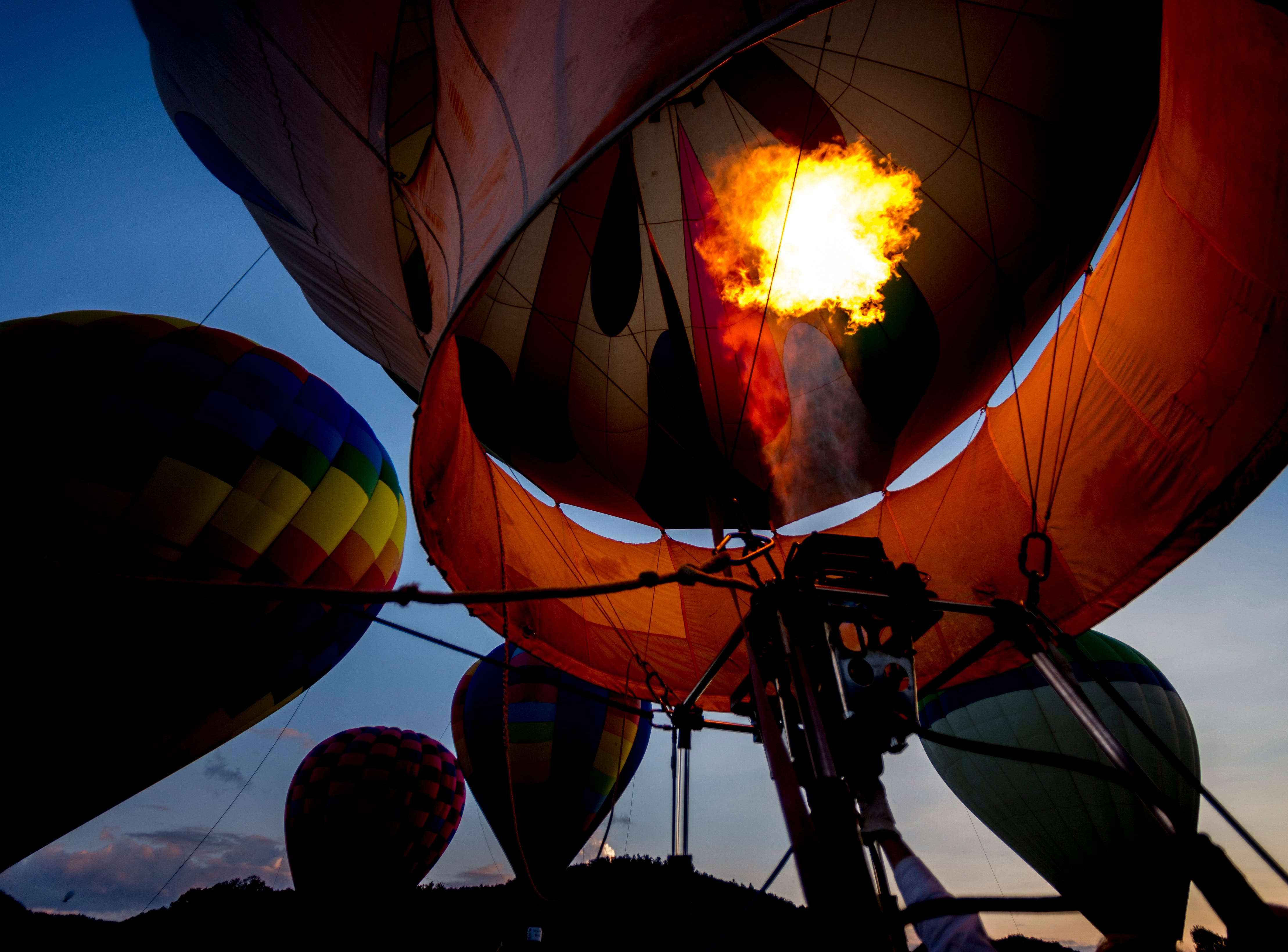 The propane burners blast heat into the hot air balloons at the second annual Smoky Mountain Balloon Festival in Townsend, Tennessee on Saturday, August 18, 2018. The festival featured several hot air balloons, food trucks, wine tasting and live entertainment.