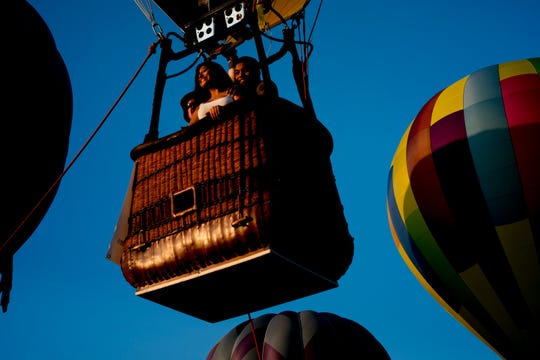 Jamie Velasquez, of Chattanooga, and Erik Lopez take a ride in a hot air balloon at the second annual Smoky Mountain Balloon Festival in Townsend, Tennessee on Saturday, August 18, 2018. The festival featured several hot air balloons, food trucks, wine tasting and live entertainment.