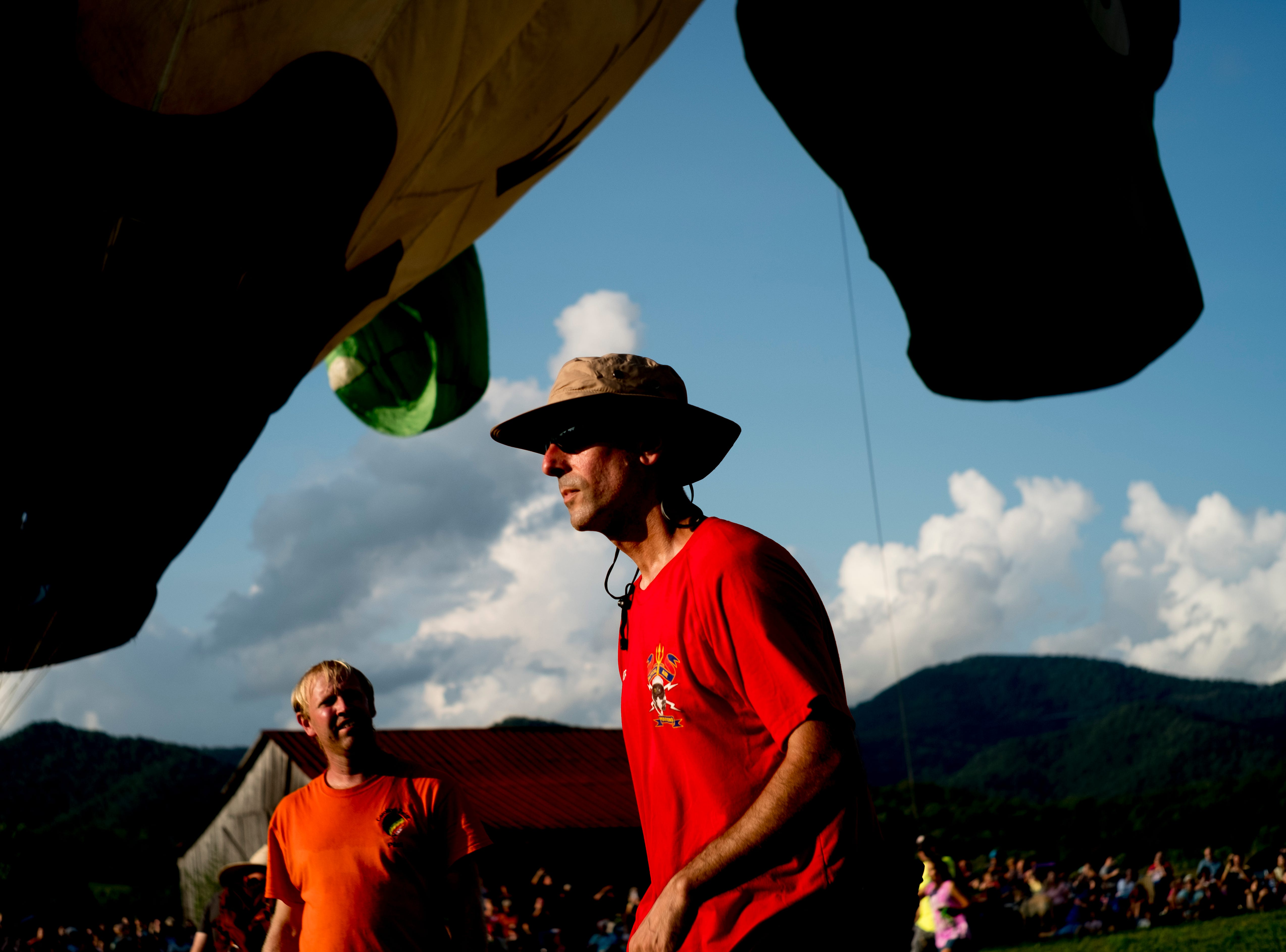 Festival team members work to inflate the hot air balloons at the second annual Smoky Mountain Balloon Festival in Townsend, Tennessee on Saturday, August 18, 2018. The festival featured several hot air balloons, food trucks, wine tasting and live entertainment.