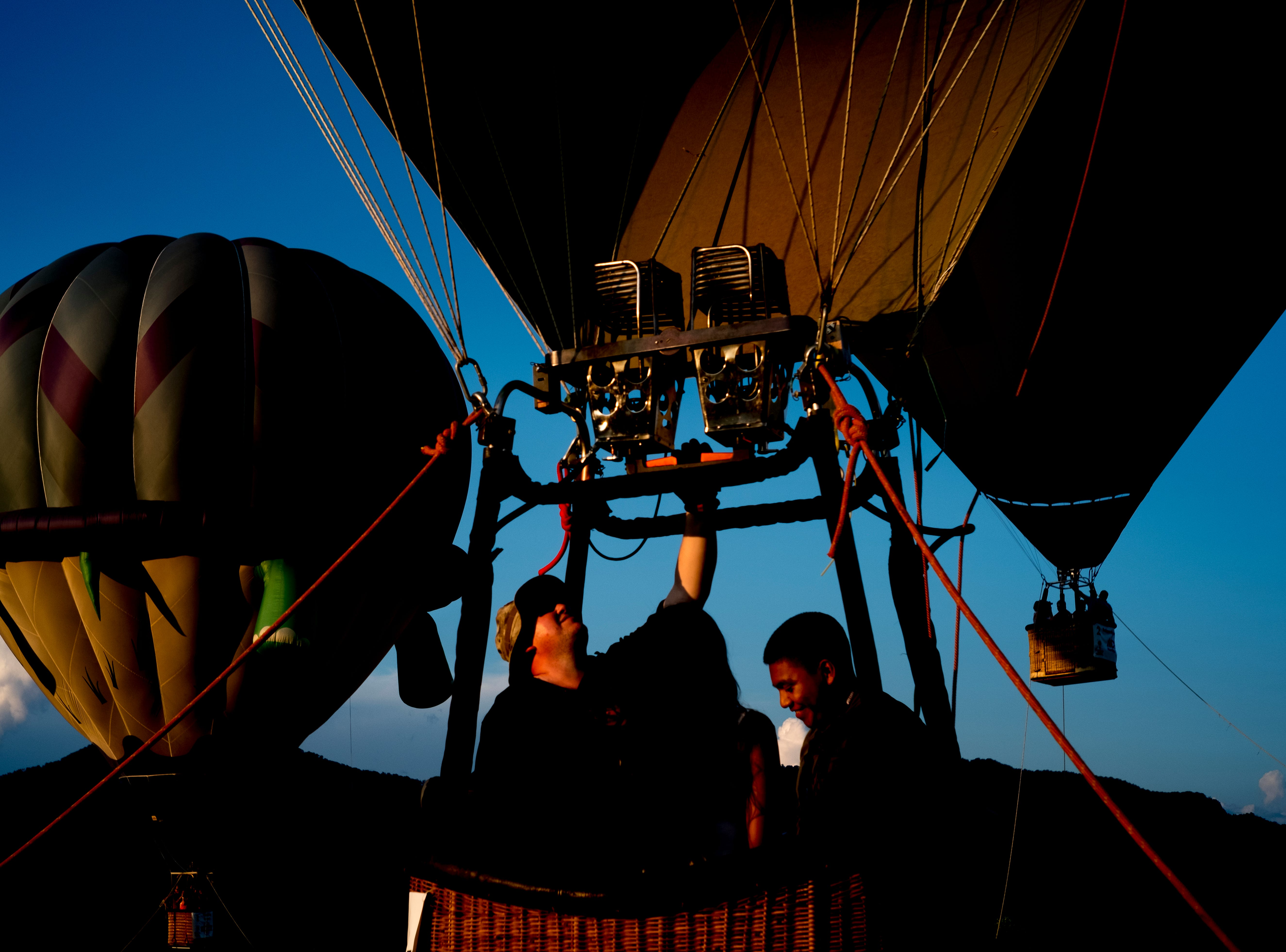 Sean Richardson gives Jamie Velasquez, of Chattanooga, and Erik Lopez a ride in his hot air balloon at the second annual Smoky Mountain Balloon Festival in Townsend, Tennessee on Saturday, August 18, 2018. The festival featured several hot air balloons, food trucks, wine tasting and live entertainment.