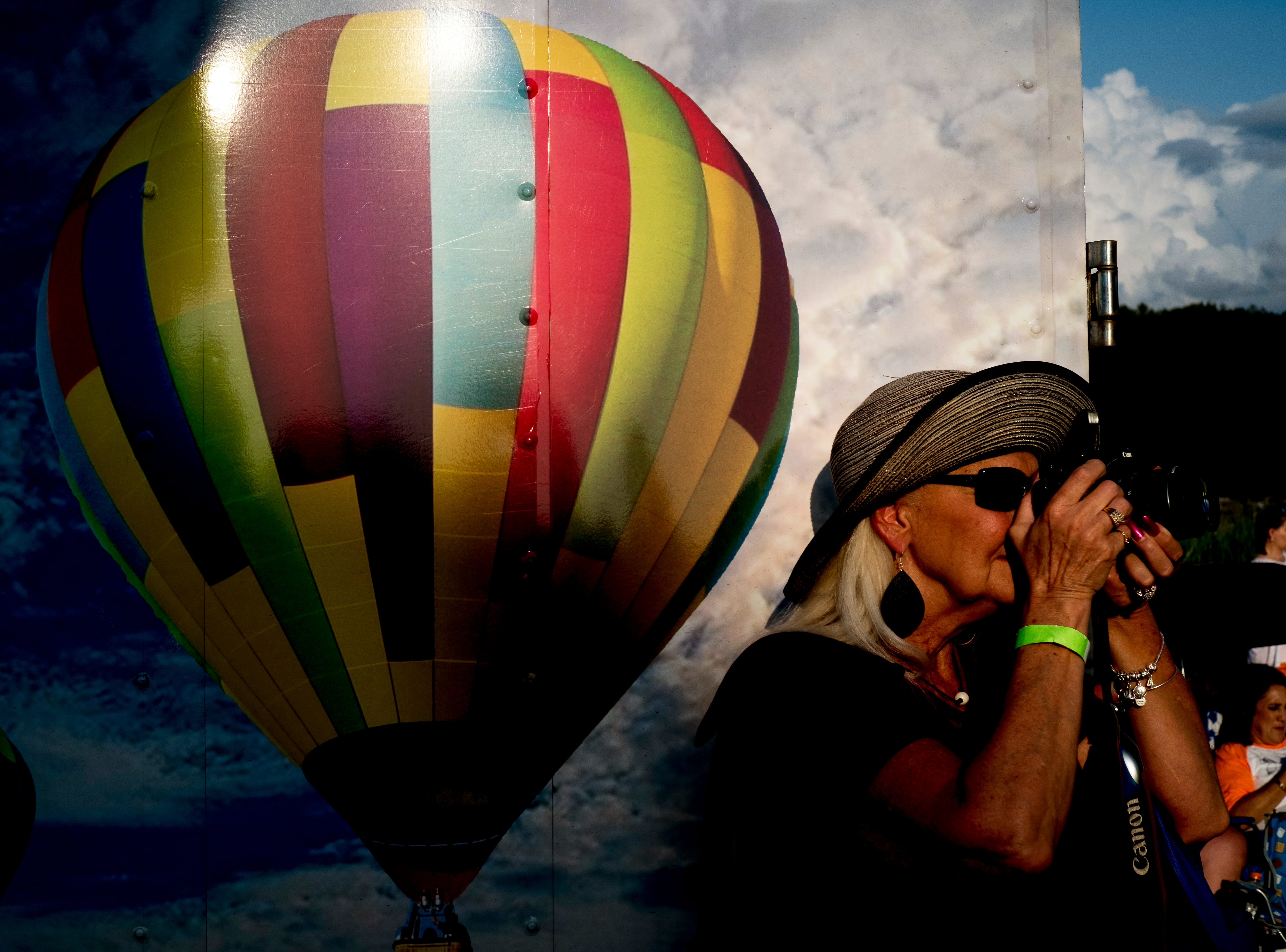 A visitor snaps a photo of the hit air balloons at the second annual Smoky Mountain Balloon Festival in Townsend, Tennessee on Saturday, August 18, 2018. The festival featured several hot air balloons, food trucks, wine tasting and live entertainment.