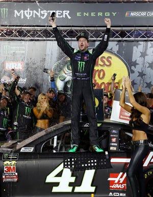 Kurt Busch celebrates after winning the NASCAR Cup Series auto race Saturday, Aug. 18, 2018, in Bristol, Tenn. (AP Photo/Wade Payne)