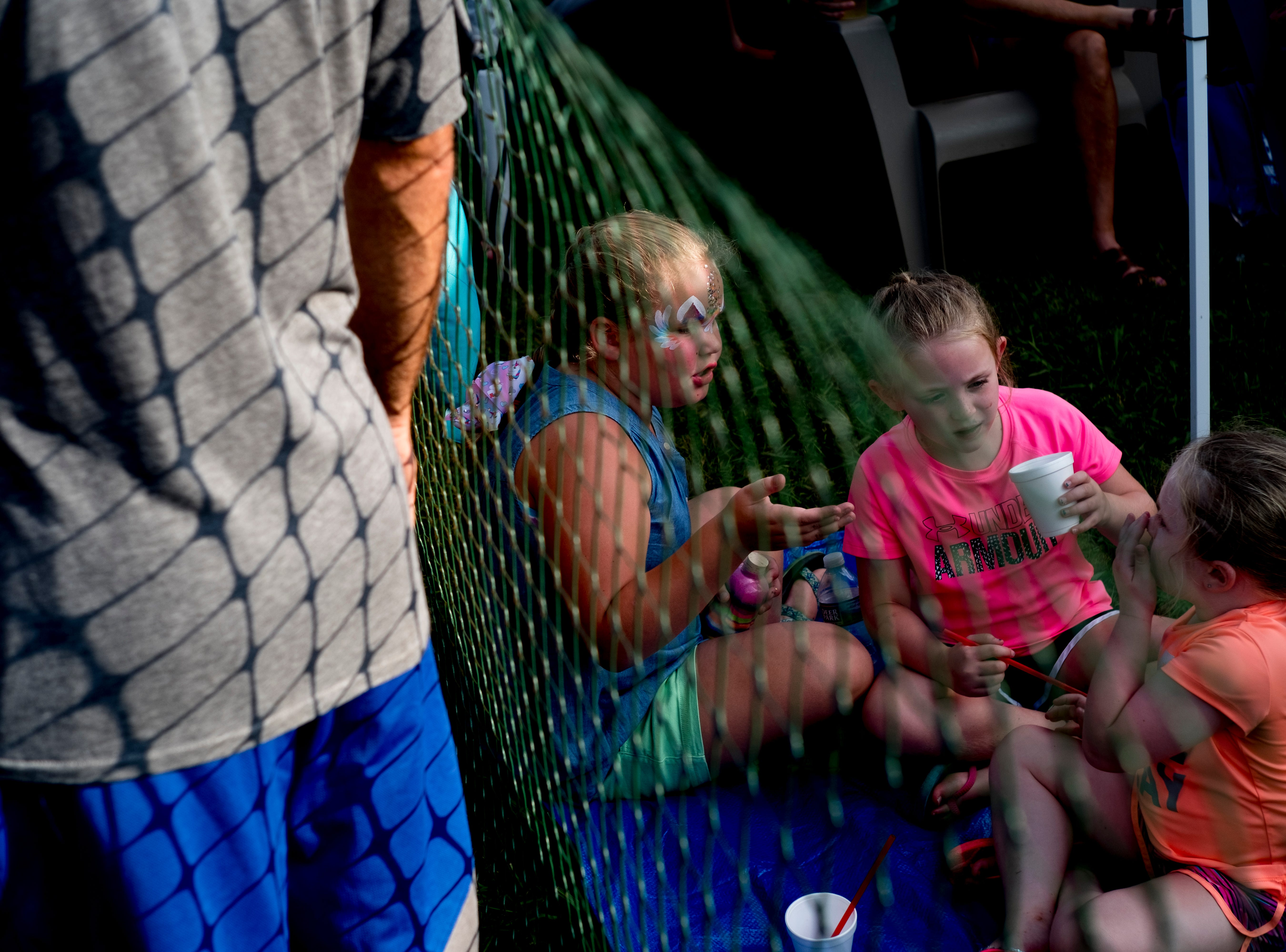 Children beat the heat at the second annual Smoky Mountain Balloon Festival in Townsend, Tennessee on Saturday, August 18, 2018. The festival featured several hot air balloons, food trucks, wine tasting and live entertainment.