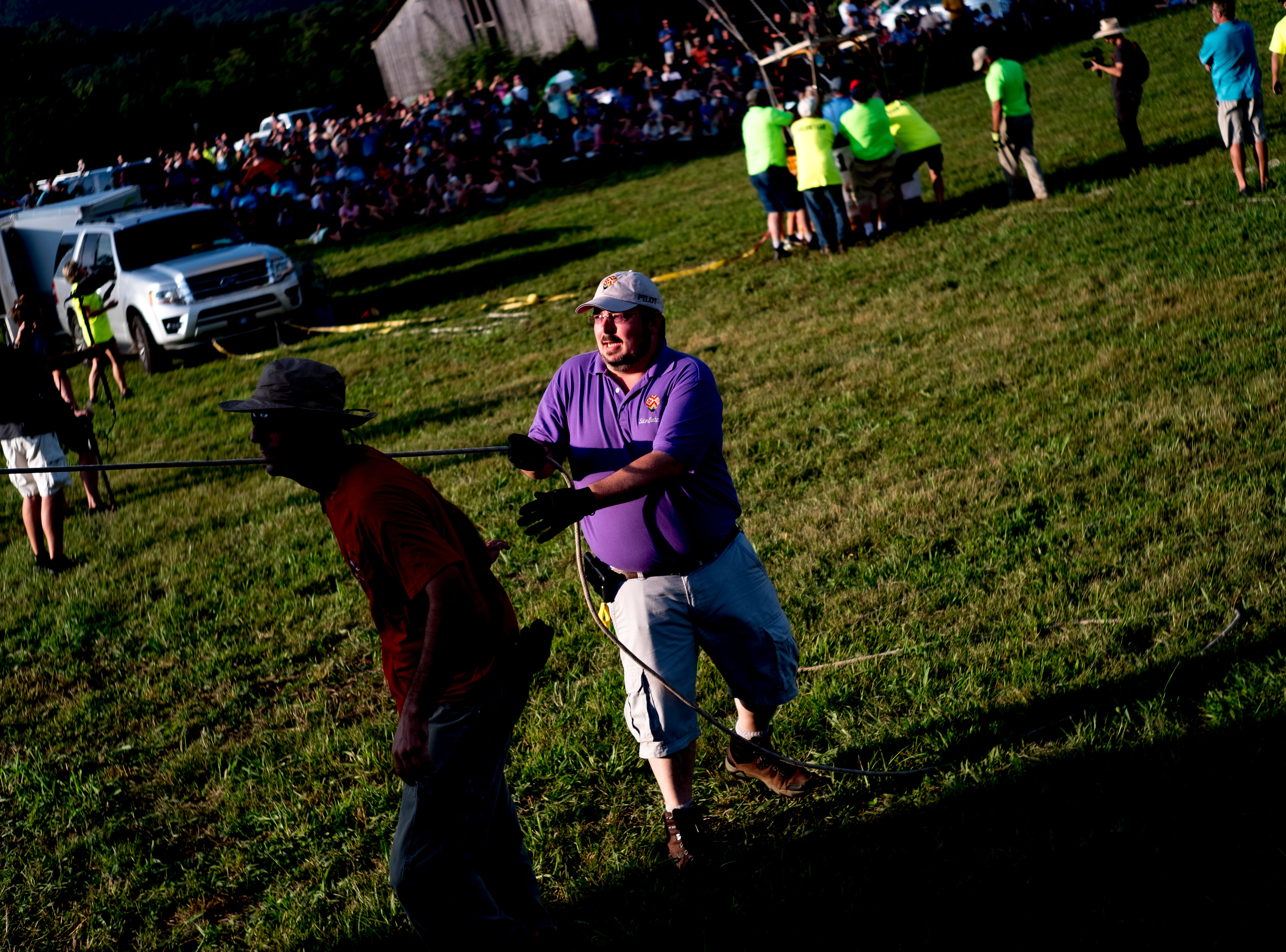 Jospeh Hurdt helps inflate a hot air balloon at the second annual Smoky Mountain Balloon Festival in Townsend, Tennessee on Saturday, August 18, 2018. The festival featured several hot air balloons, food trucks, wine tasting and live entertainment.