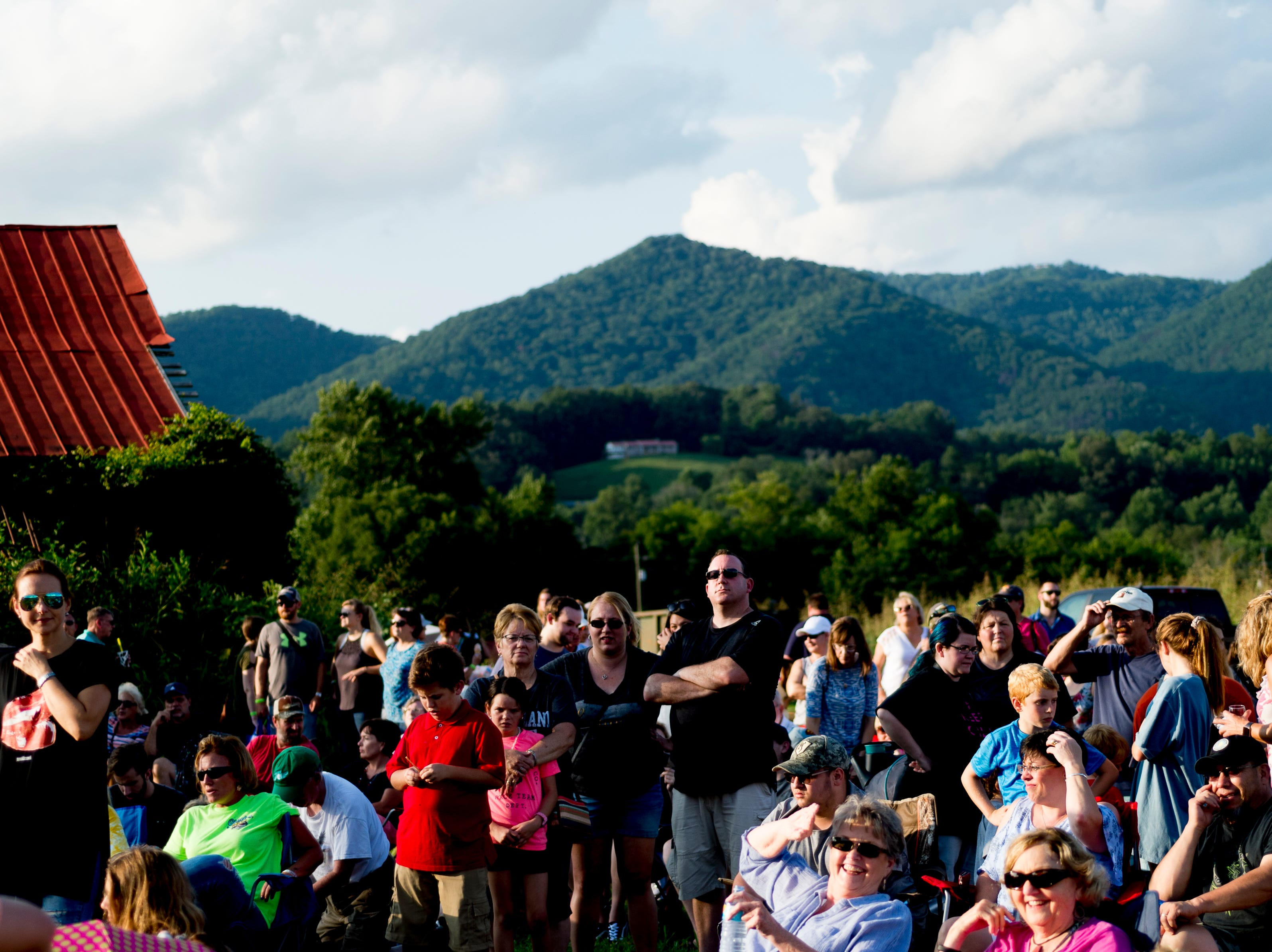 Visitors watch as the balloons are inflated at the second annual Smoky Mountain Balloon Festival in Townsend, Tennessee on Saturday, August 18, 2018. The festival featured several hot air balloons, food trucks, wine tasting and live entertainment.